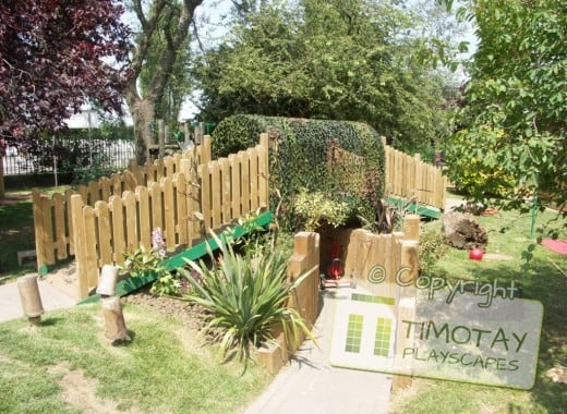 Wooden Bridge in garden with Timotay Playscapes logo overlaid